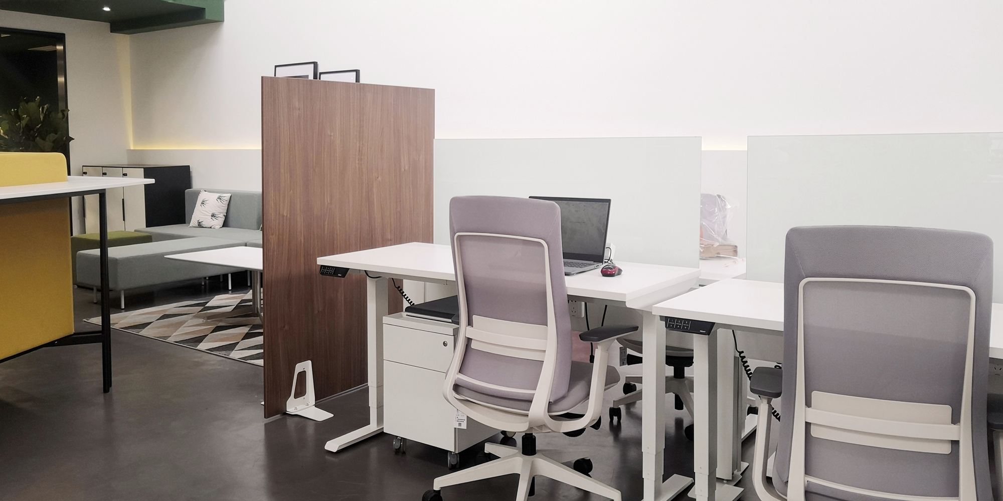 Image showcases Friant Shield panel next to a workstation
