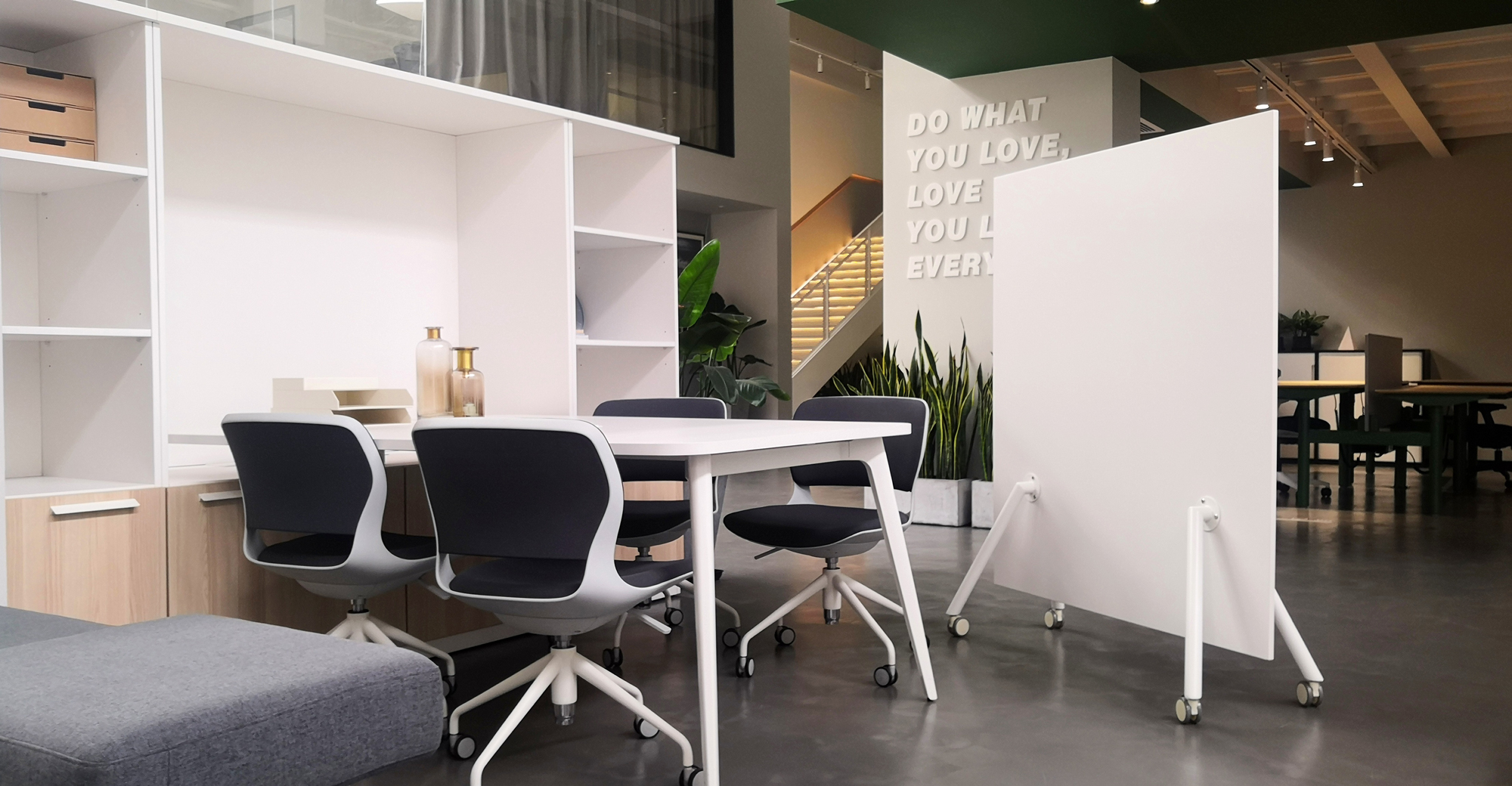 Image showcases Friant Shield panel creating space for an open meeting area
